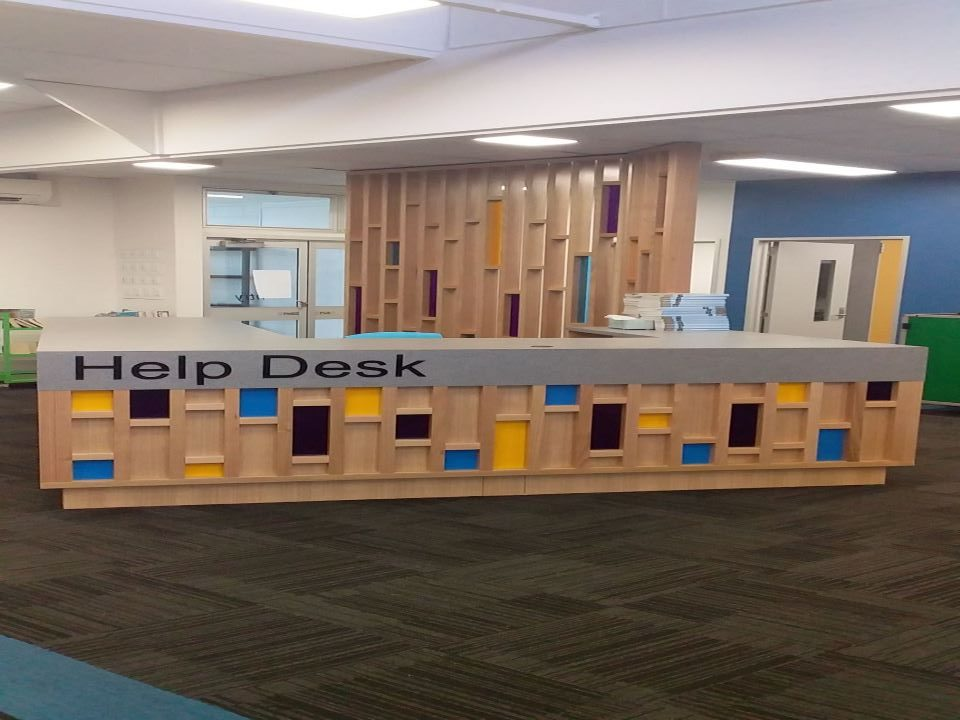 Library help desk and frame board at the background by Hassum & Levitt Cabinet Makers